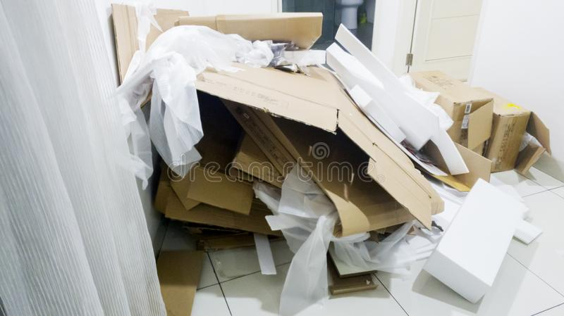 Cardboard box and styrofoam for recycling. Heap of used cardboard box and styrofoam trash for recycling on the warehouse stock photography