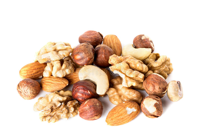 Heap from various kinds of nuts almond, walnut, hazelnut, cashew, Brazil nut isolated on white royalty free stock image