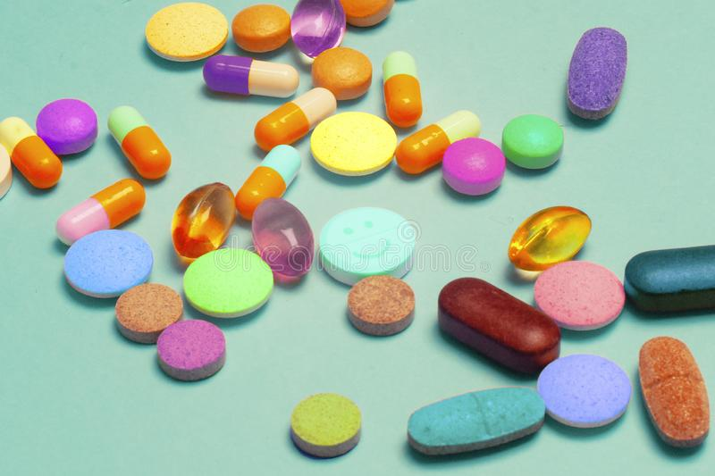 Heap of various pills on color background. LSD pills drugs, bright Psychedelic pill stock photos