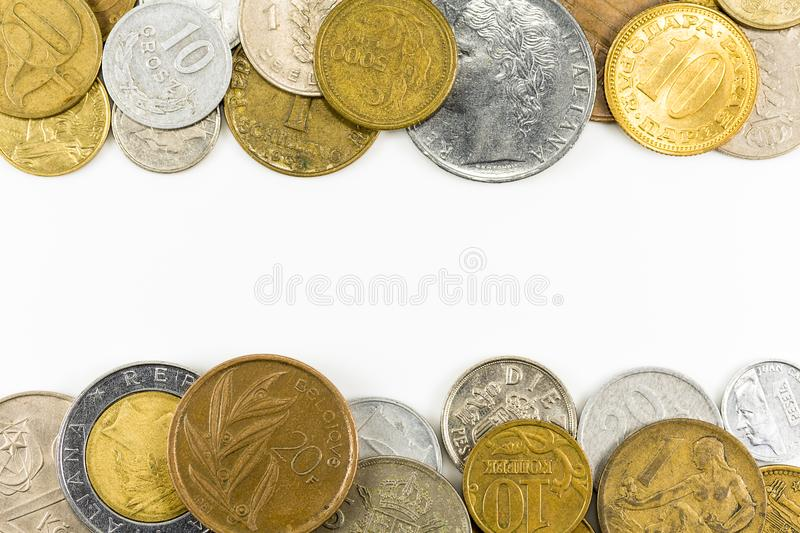 Heap of vintage coins on the top and bottom. On white background royalty free stock photos