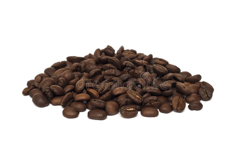Heap of whole coffee beans on a white background royalty free stock photos