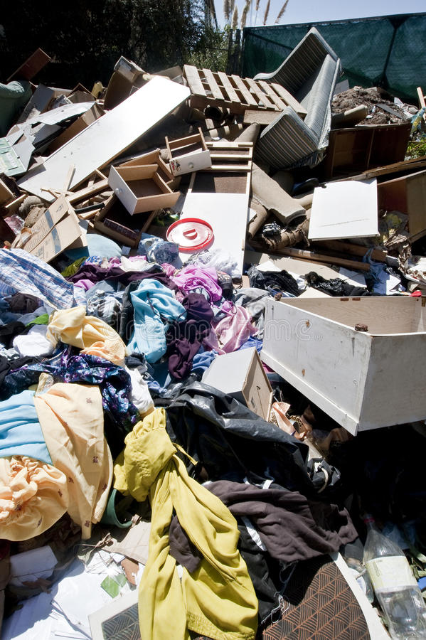 Heapes of household refuse. Household junk dumped on the side of the road. Copyspace stock photos