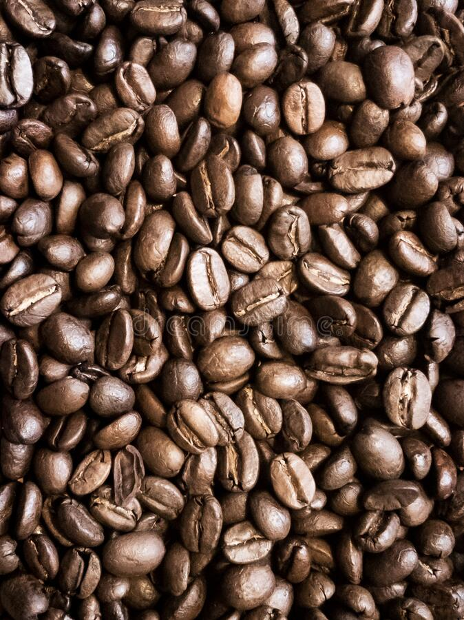 A heaping pile of roasted coffee beans stock image