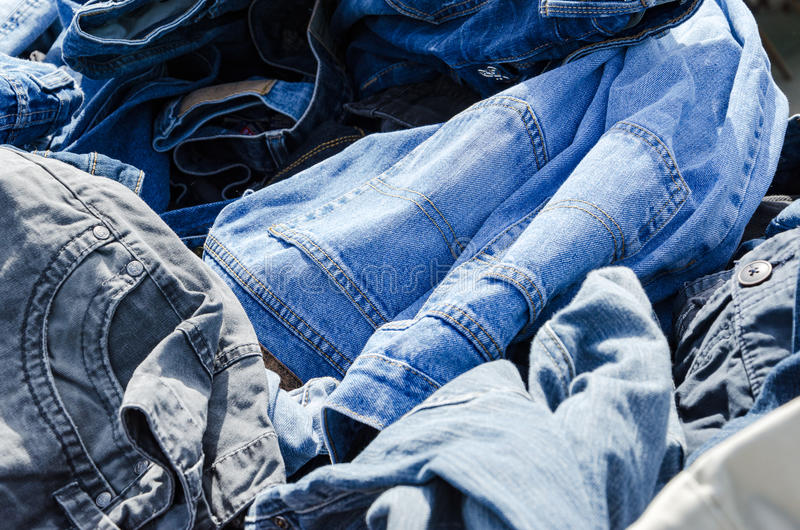 Heaps of clothing on the second hand market royalty free stock images