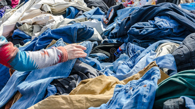 Heaps of clothing on the second hand market royalty free stock photos