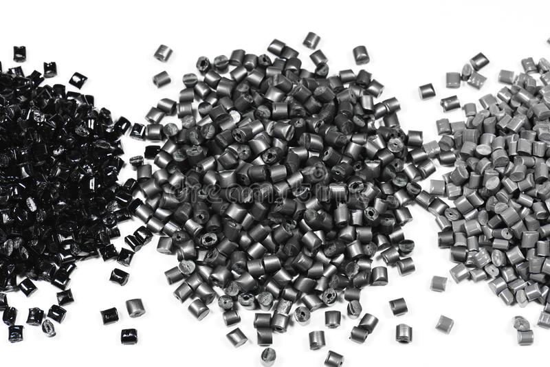 3 heaps of gray polymer. Heaps of gray metallic polymer resin in factory royalty free stock photos