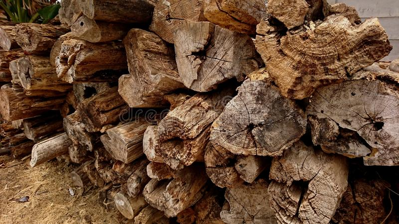 Heaps of old teak wood damaged by corrosion stock photo