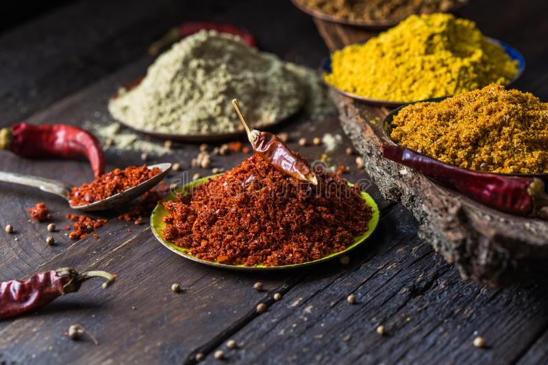 Heaps of various ground spices on wooden background. Georgian spices, Indian spices, Arabian spices. Spice variety. Herbs and spic royalty free stock photo
