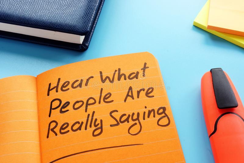 Hear what people are really saying sign. Active listening technique concept. Hear what people are really saying sign in the note. Active listening technique stock photo