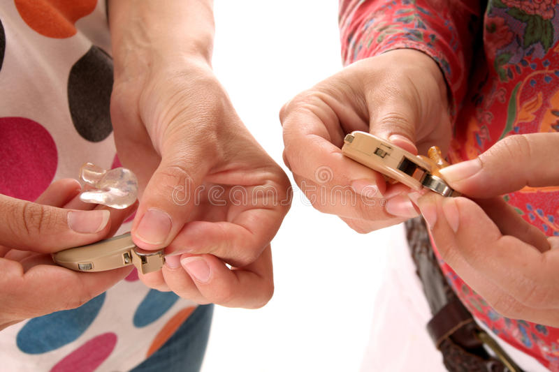 Hearing aid and battery stock photo