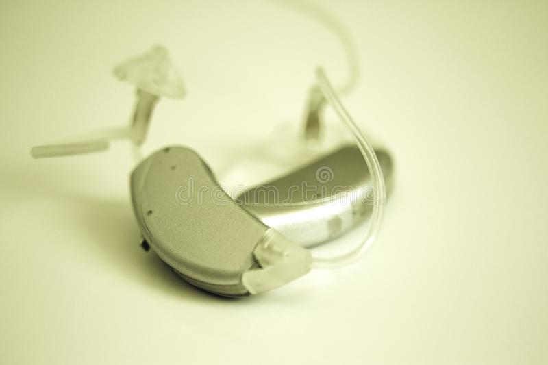 Hearing aid for deaf people stock images