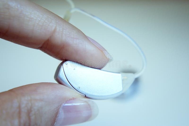 Hearing aid for deaf people stock photo
