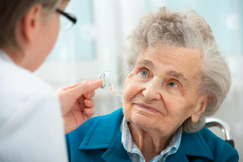Hearing Aid. Deaf senior women during a hearing test royalty free stock images