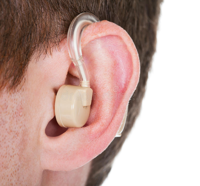 Hearing aid on the man's ear. Close-up Of Hearing Aid On The Man's Ear stock images