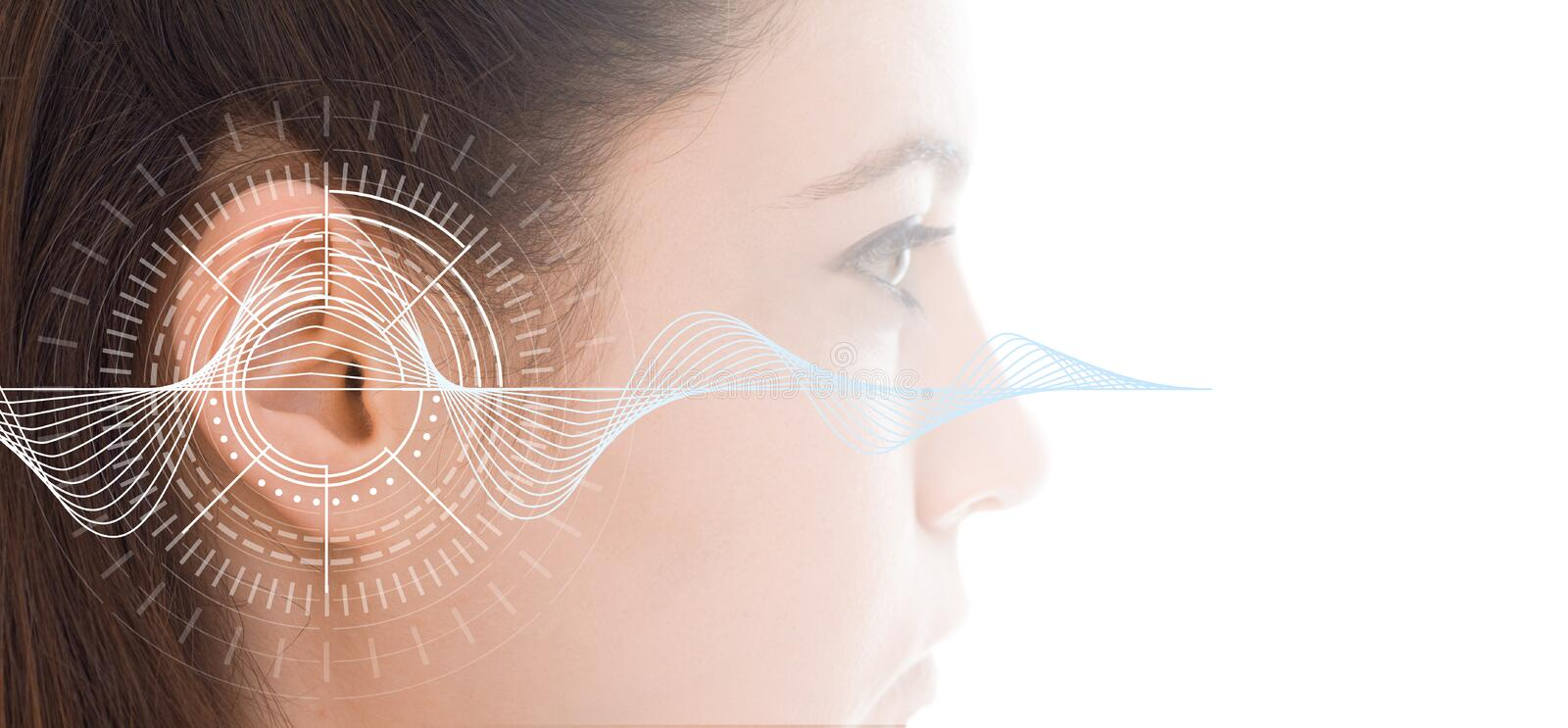 Hearing test showing ear of young woman with sound waves simulation technology royalty free stock photography