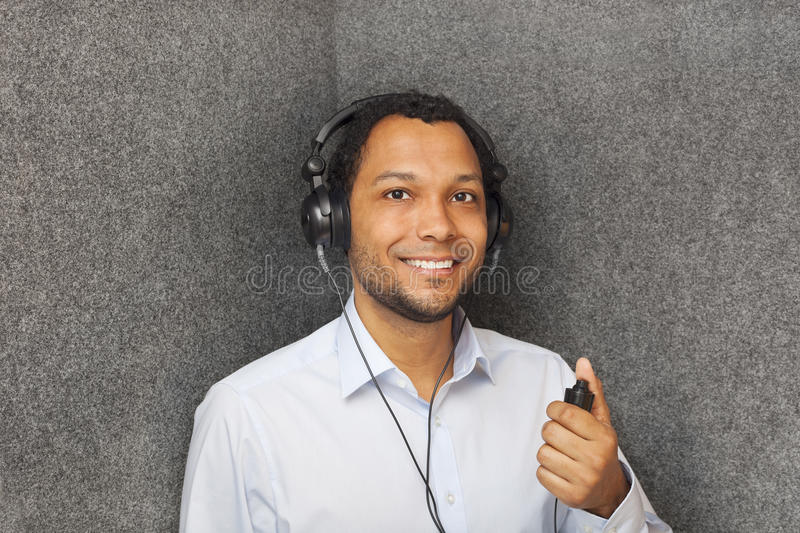Hearing Test. Young man in audiology booth doing a Hearing Test stock photography