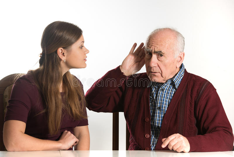 Hearing test. Young women makes hearing test for old senior man stock photos