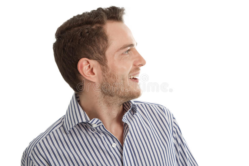 Hearing - Young man in blue shirt looking sideways isolated on w royalty free stock image