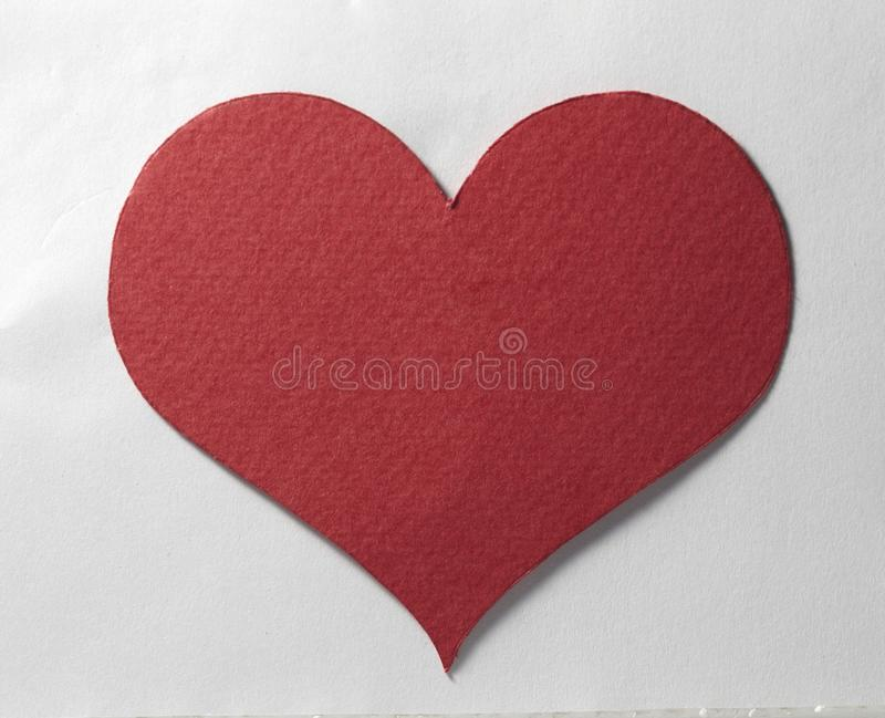 Heart. A piece of bright red paper cut into the shape of a heart