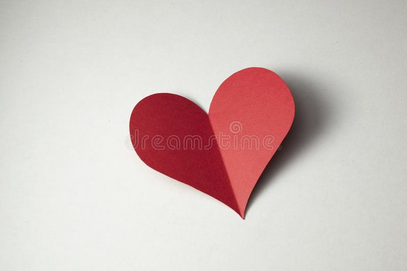 Heart. A piece of paper cut into a shape of a heart