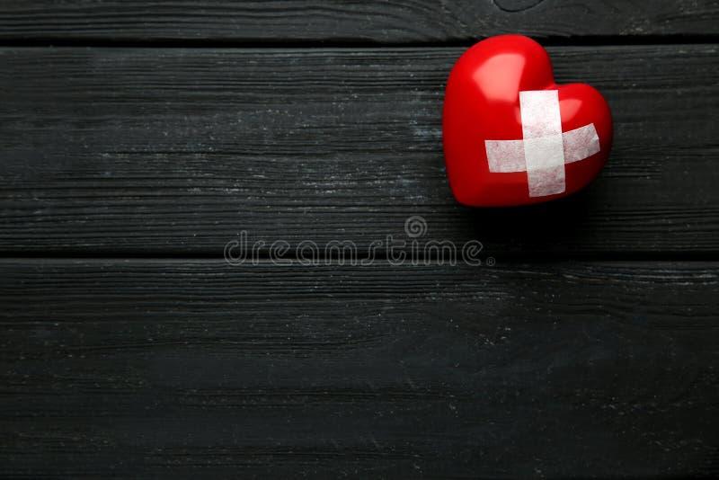 Heart with adhesive bandage stock photos