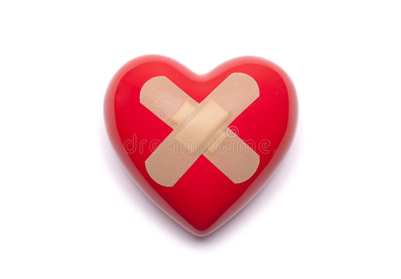Heart with adhesive plaster stock image