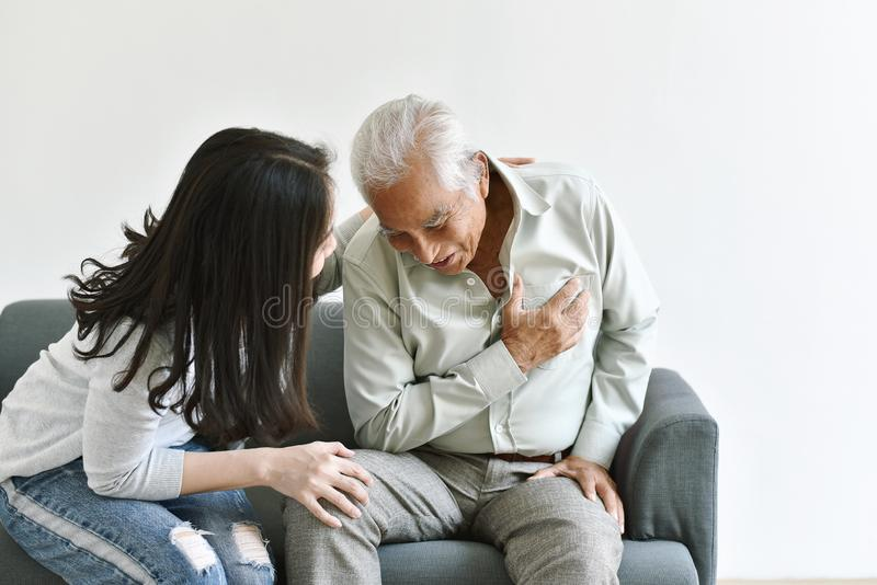 Heart attack disease problem in old man, Elderly asian man with hand on chest gesture. Heart attack disease problem in old man, Elderly asian men with hand on stock photo