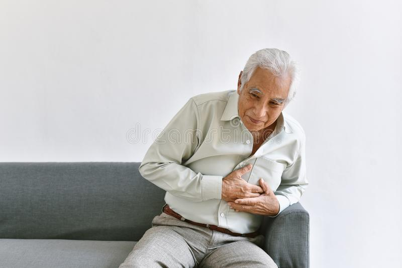 Heart attack disease problem in old man, Elderly asian man with hand on chest gesture. Heart attack disease problem in old man, Elderly asian man with hand on stock photos