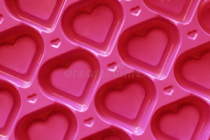 Heart Background. Pink hearts background - the symbol of love royalty free stock image