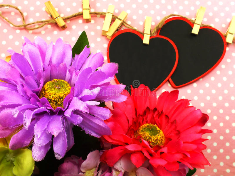 Heart background valentine's day with beautiful flower bouqet. On pink background royalty free stock image