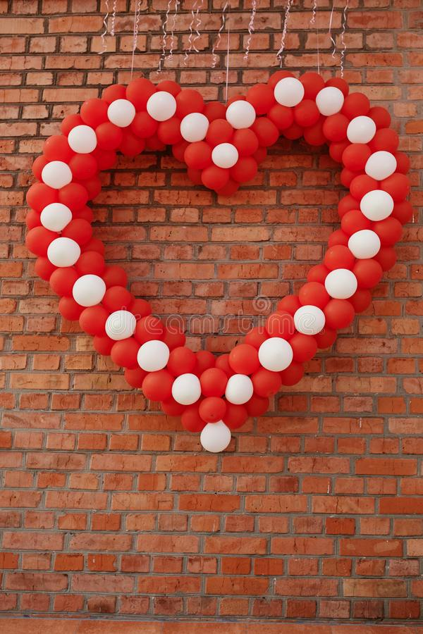 Heart of balloons against the background of the wall. concept for valentines day royalty free stock images