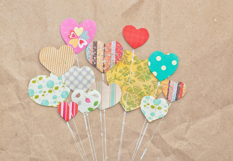 Heart Balloons. Colorful heart balloons in envelope on vintage background stock photo