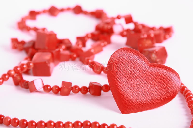 Download Heart and beads on white stock photo. Image of shine - 12010592