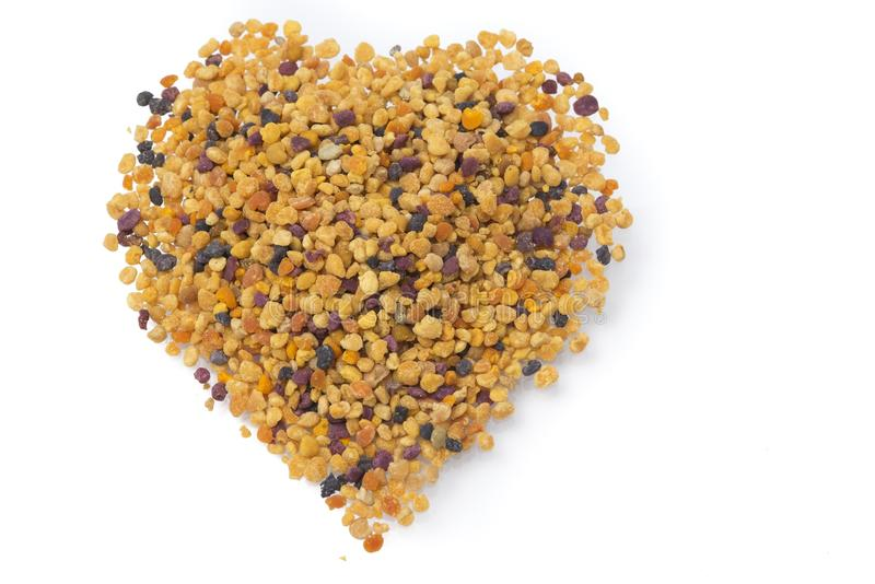 Heart of bee pollen. Healthy superfoods royalty free stock photo