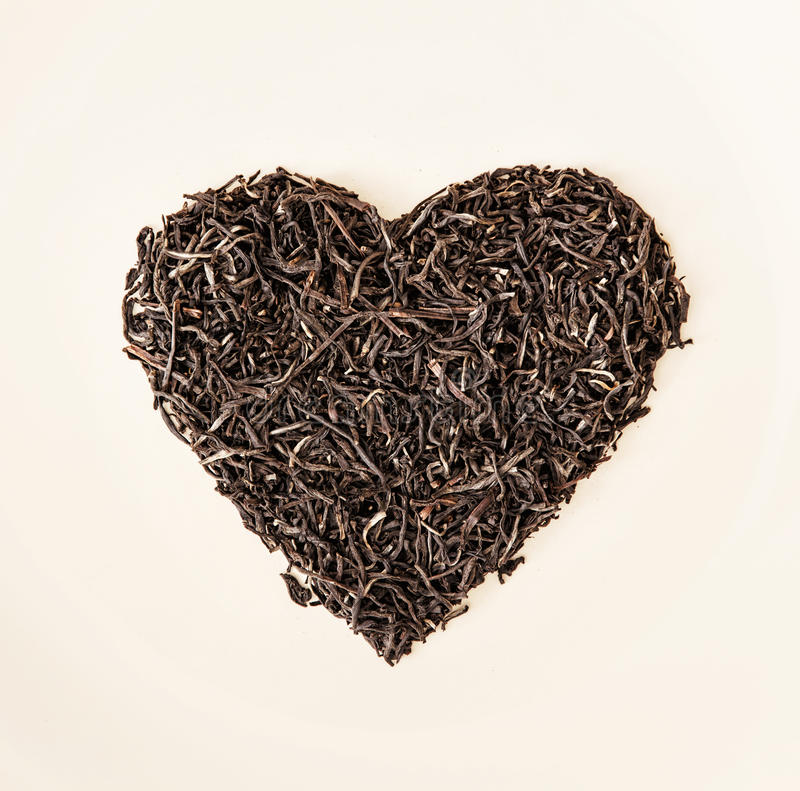 Heart of black loose tea from Ceylon, Valentine's day. Heart of black loose tea from Ceylon. Valentine's day. Symbol of lovers royalty free stock images