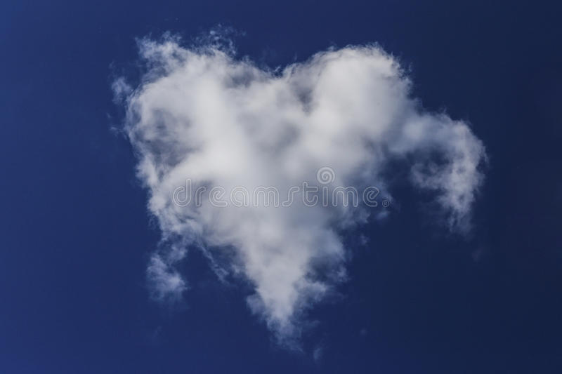 Heart in the blue sky stock images
