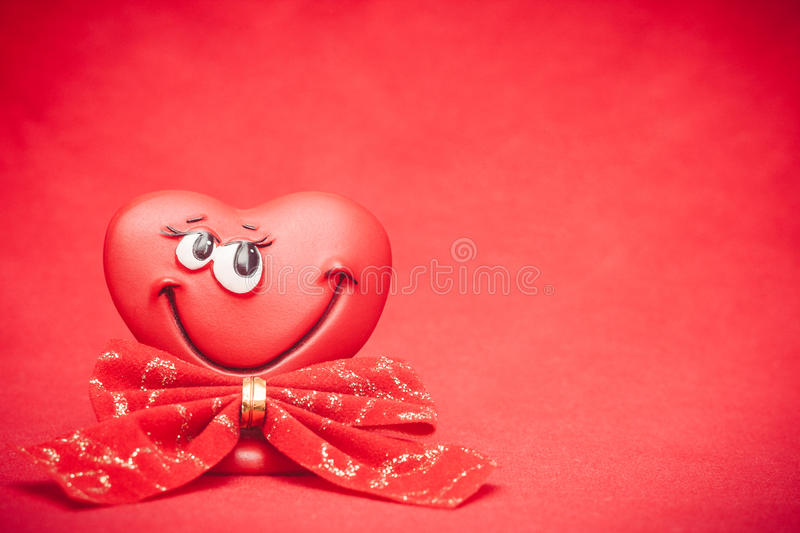 Heart with bow. Happy red love heart with bow Valentines Day background royalty free stock photography
