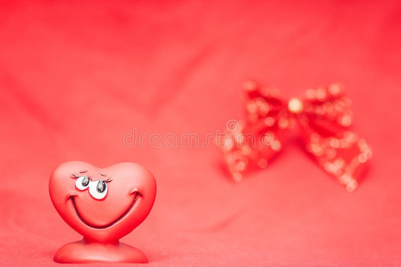 Heart with bow. Happy red love heart with bow Valentines Day background stock image