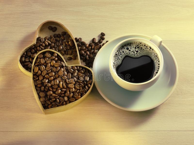 Love Coffee Cup. Heart box of coffee beans with cup of fresh black coffee on wood background stock photo