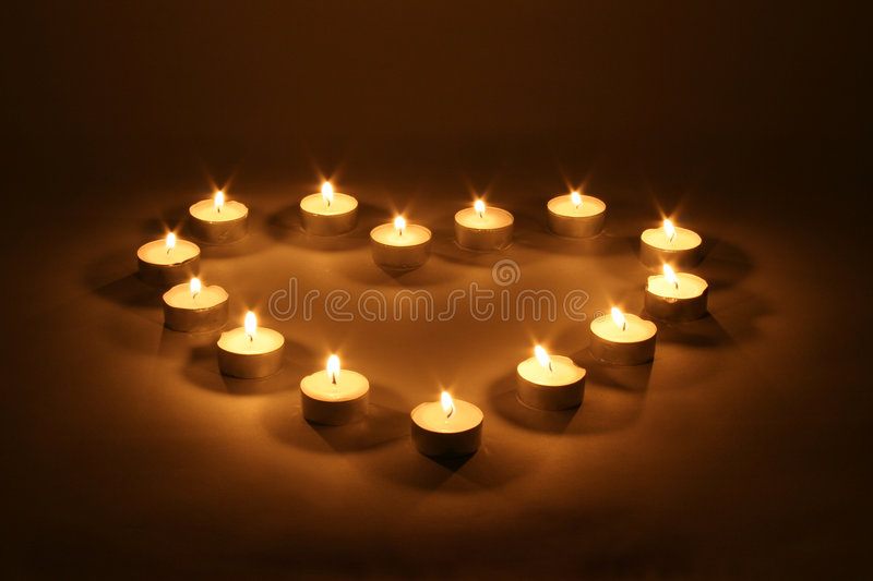 Heart of candles. Heart made with little candles royalty free stock image