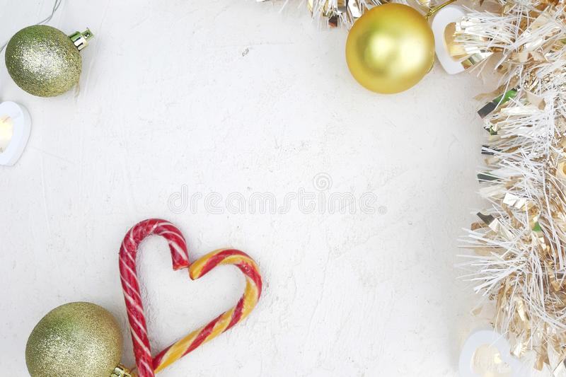Heart candy cane, decoration balls, tinsel on white background. stock photography
