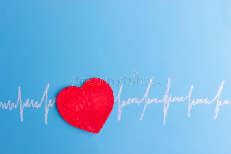 Heart and cardiogram stock photo