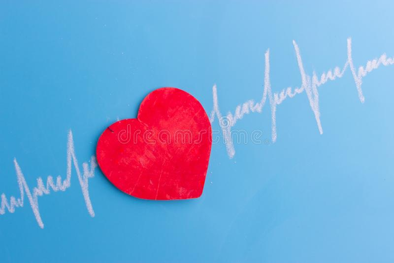 Heart and cardiogram stock image