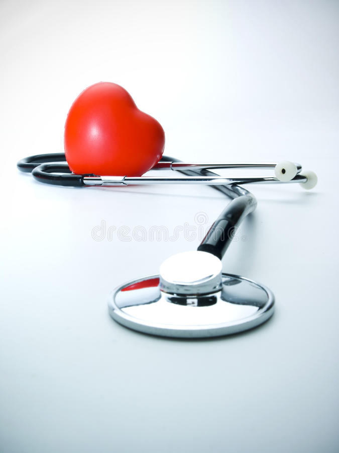 Heart Care. Heart and a stethoscope with blue tint