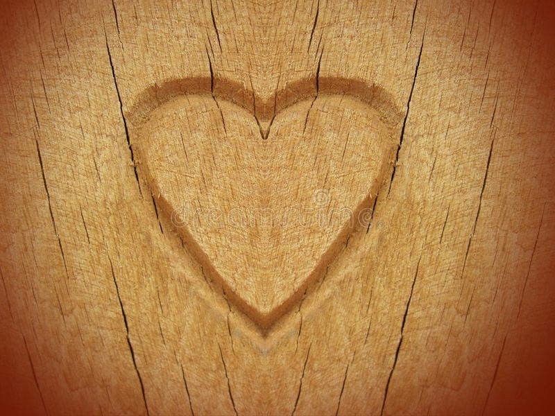 Heart carved on wood. Can use as background stock photo