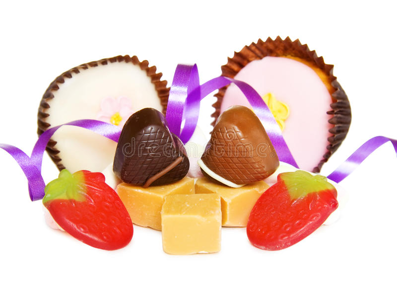 Heart chocolates with mix of sweets on white royalty free stock image