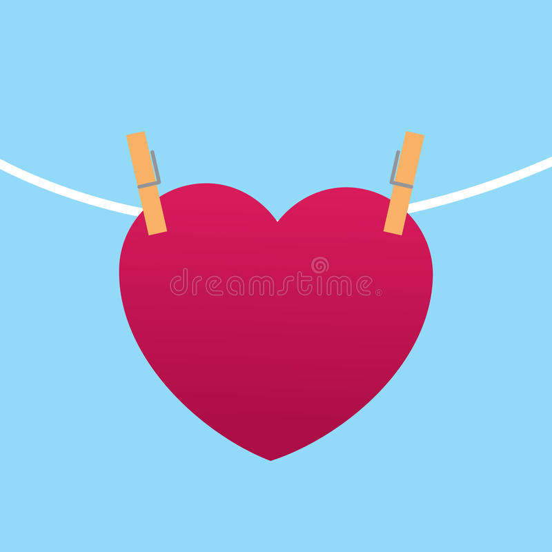 Heart Clipped to String. With blue background stock illustration