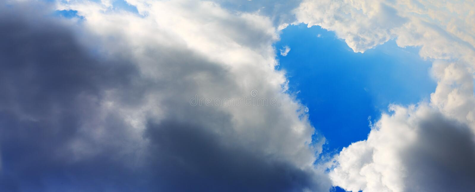 Heart shapes cloud on blue sky. royalty free stock photography