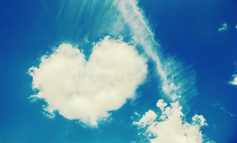 Heart from a cloud in the sky. Selective focus stock photo
