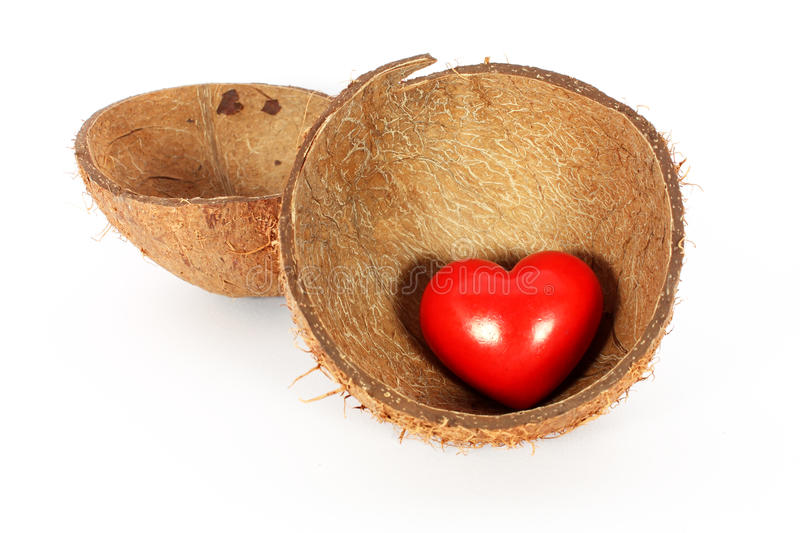 Heart in coconut shell stock photos